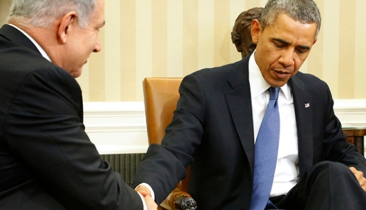 Obama shakes hands with Netanyahu as they sit down to meet in the Oval Office of the White House in Washington